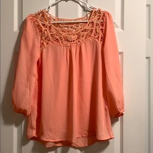 EUC peach blouse with a beautiful lace neckline.